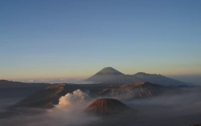 Indonesia: Lush Green Landscape And Passing Volcanoes